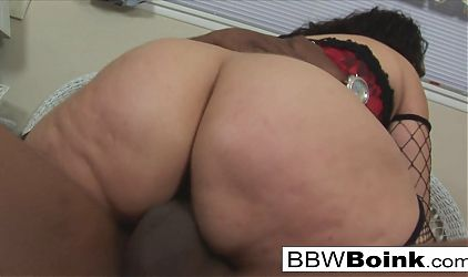 Latina BBW takes a thick black cock on the bed
